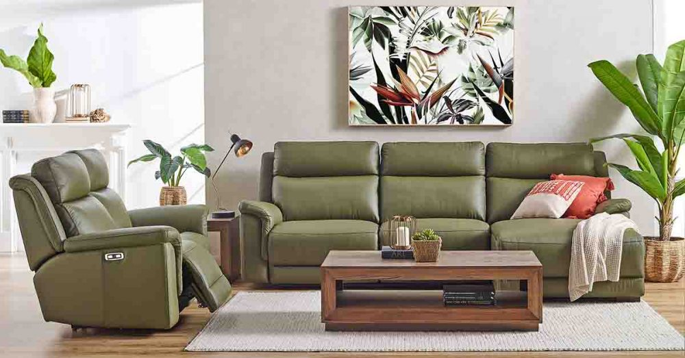 The 'Kade' 2.5-Seater Leather Powered Recliner Sofa Suite with a coffee table in front of it.