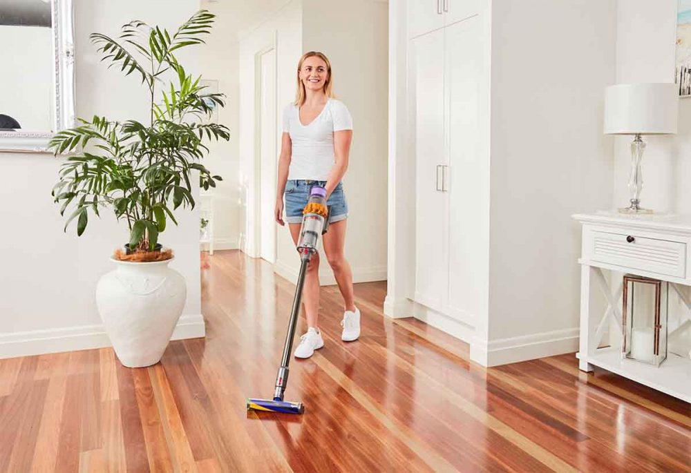 Ariarne Titmus cleaning with the Dyson V15 Detect Total Clean.