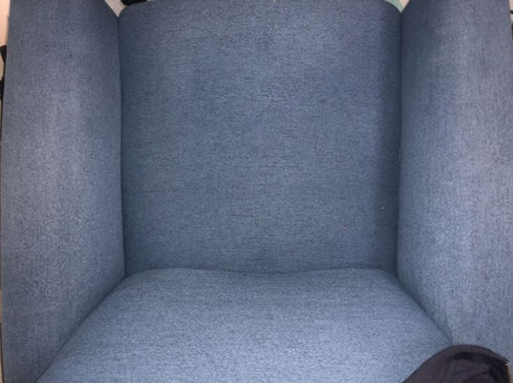An armchair before being cleaned by a Bissell SpotClean.
