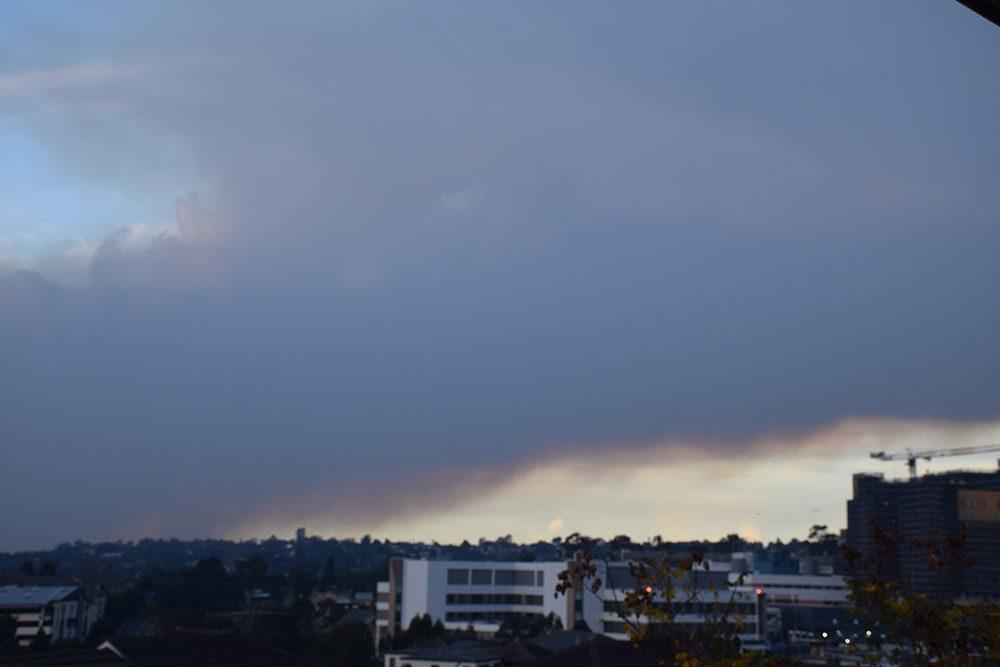 Backburning smoke hovering over suburban Sydney,