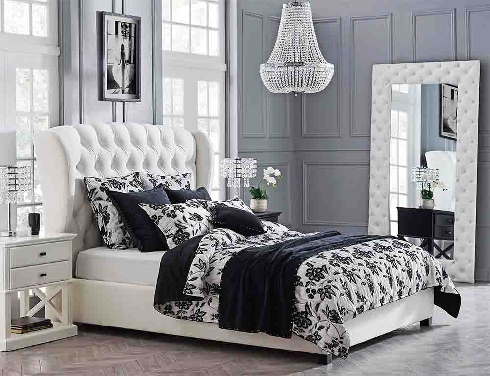 The Beatrice Bed with black and white floral Manchester on top.