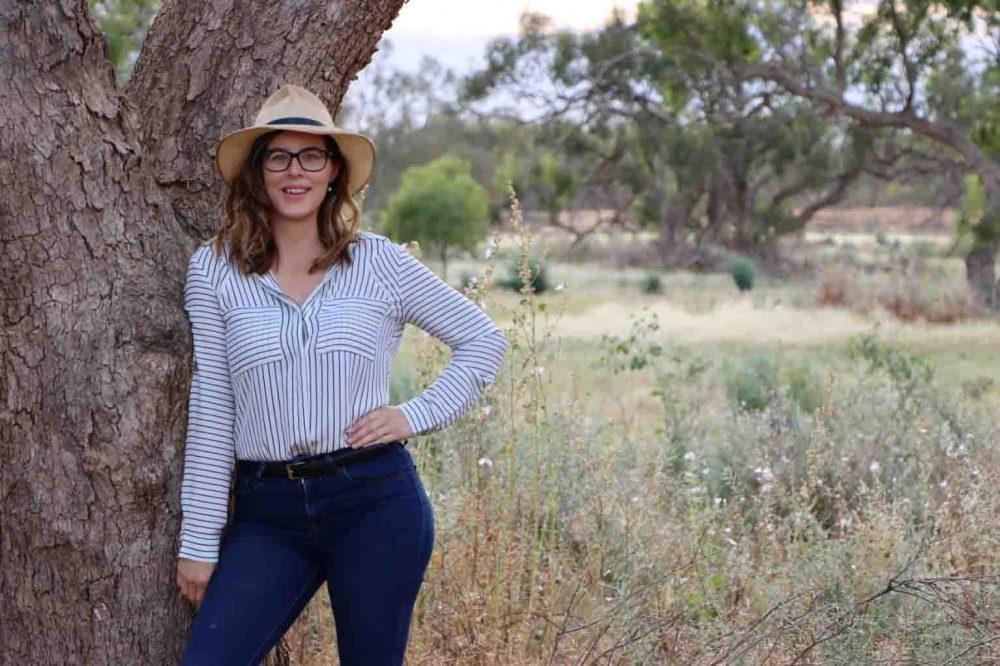 2019 Shine Awards Spirit winner, Bessie Thomas, standing next to a tree.