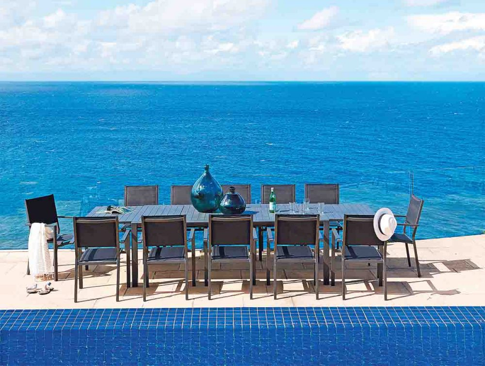 The 'Bon' Outdoor Dining Setting at a seaside location.