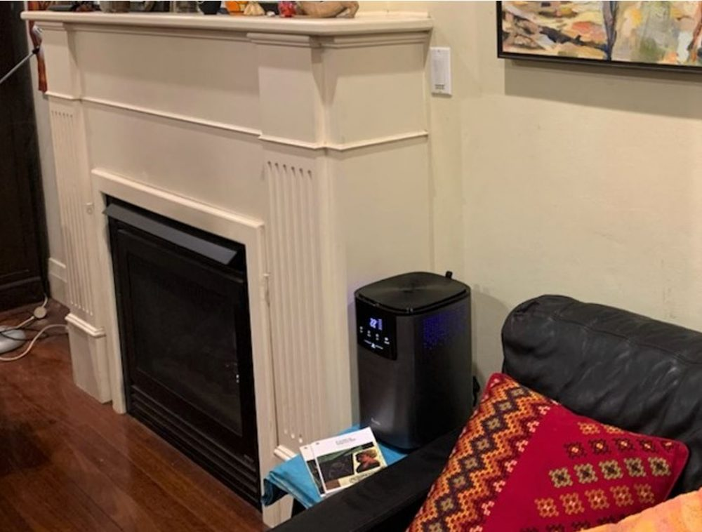 Breville the Smart Mist Top™ Connect Humidifier in a living room.