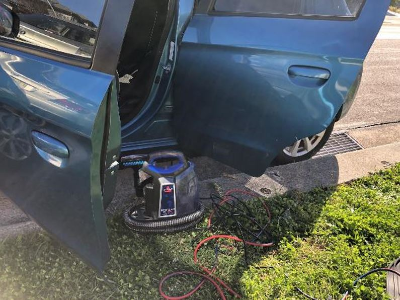 Cleaning a car with the Bissell SpotClean ProHeat Professional Carpet & Upholstery Washer.