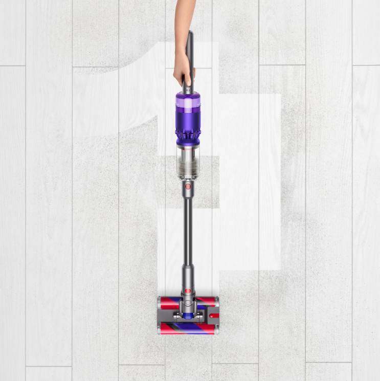 A person cleaning with the Dyson Omni-glide.