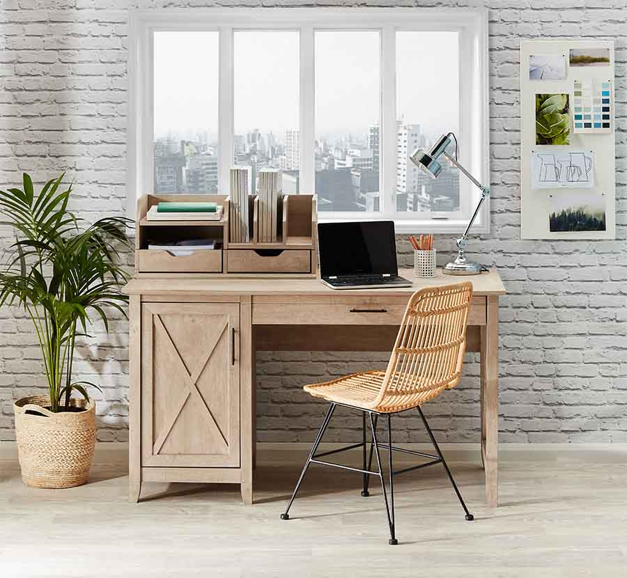 The Coastal Home Office Desk next to a window with city views.
