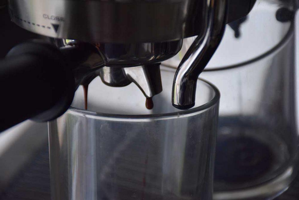 Coffee dripping from the De'Longhi La Specialista Maestro Coffee Machine.