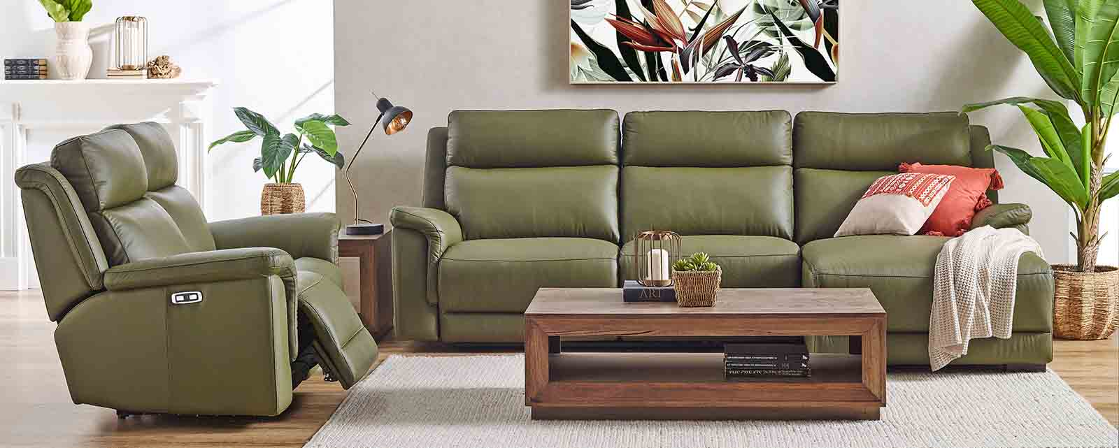 A comfortable reclining leather sofa suite.