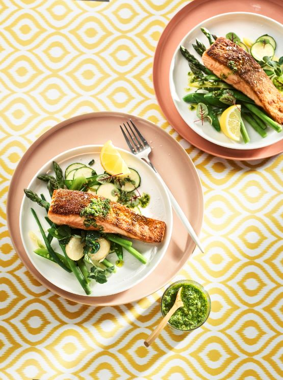 Our Crispy-skinned Salmon with Green Vegetables & Pesto Dressing recipe plated.