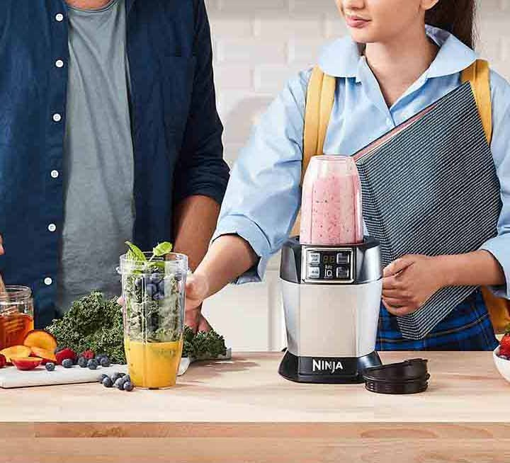 The Nutri Ninja Auto IQ Blender being used to make a Dairy-Free Berry Bliss Smoothie recipe.