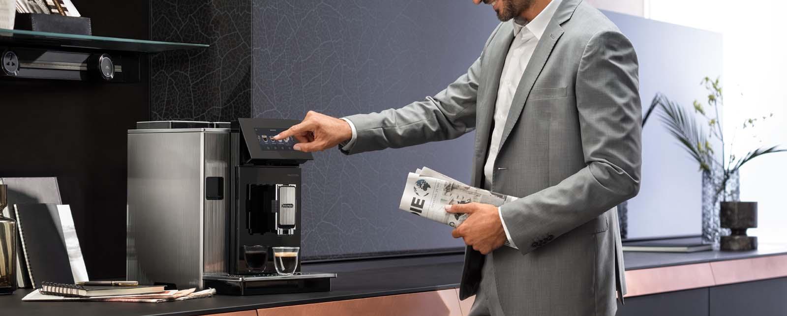 Man operating the De'Longhi Maestosa Coffee Machine.
