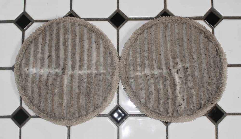 Dirty cleaning pads after mopping the bathroom floor with the Bissell SpinWave Cordless Mop.