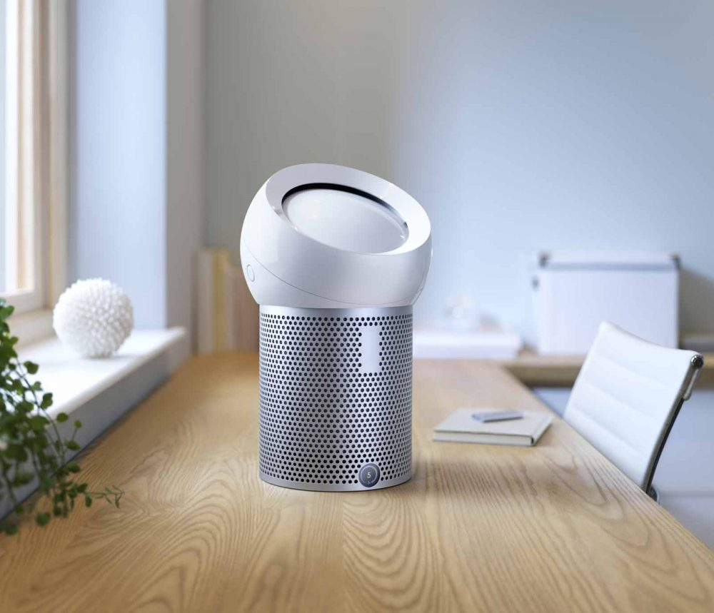 The Dyson Pure Cool Me personal purifying fan in use on a dining table.