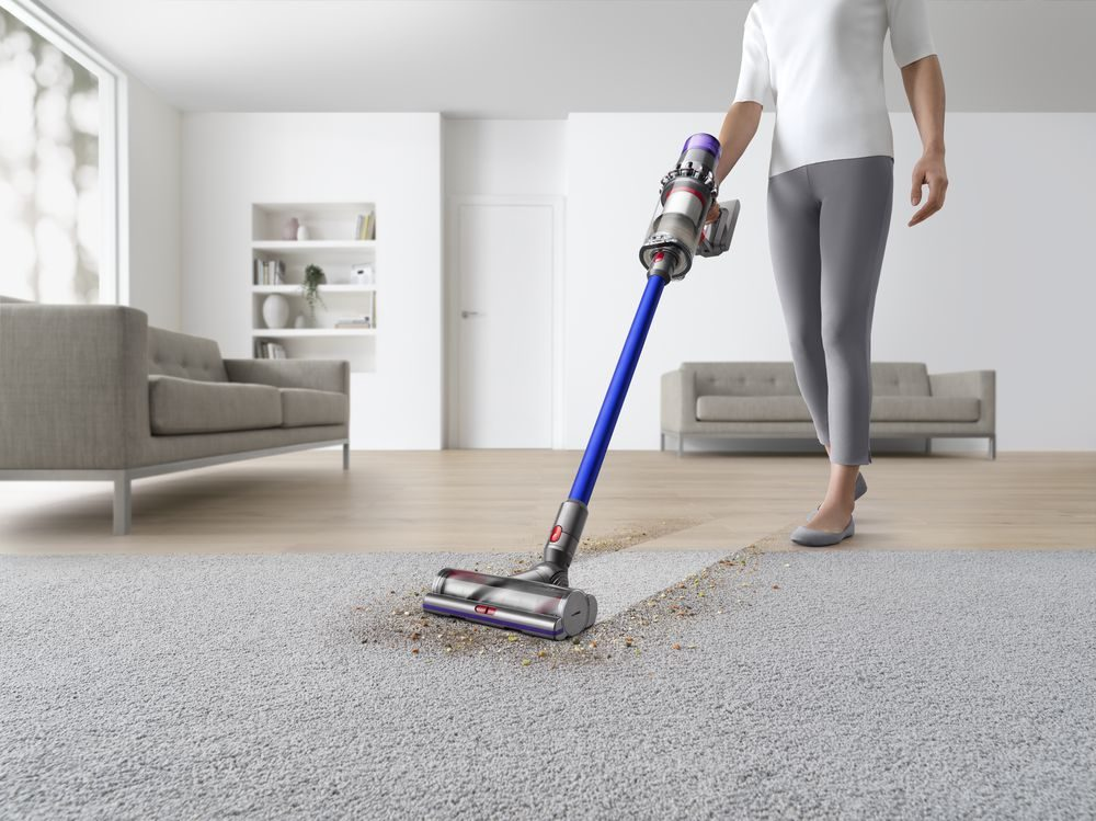 The Dyson V11 Absolute Cordless Vacuum Cleaner cleaning carpet.