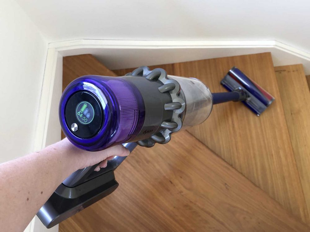 The Dyson V!11 Absolute vacuuming stairs.