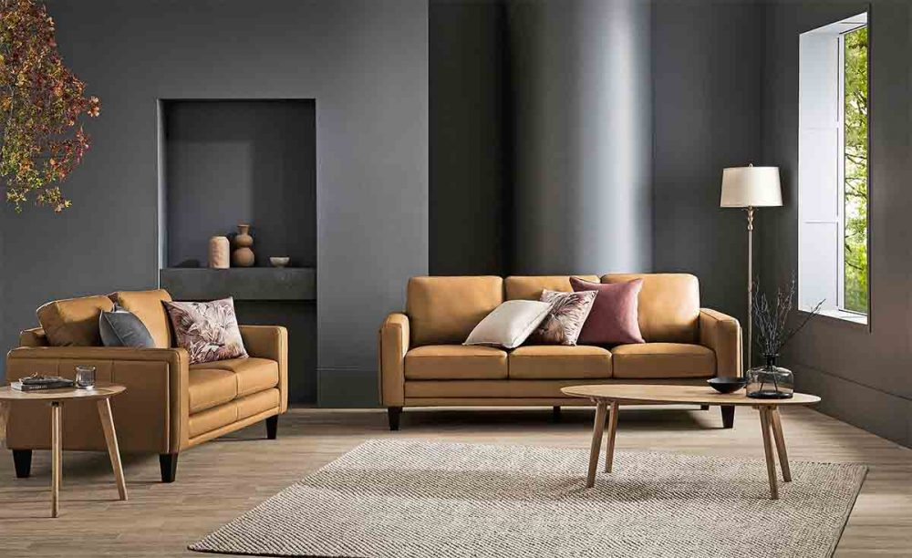 A dark wall behind the Florence 3-Seater Leather Sofa.