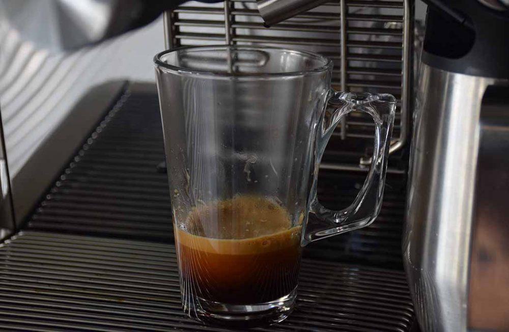 Coffee in a glass, produced by the De'Longhi La Specialista Maestro Coffee Machine.