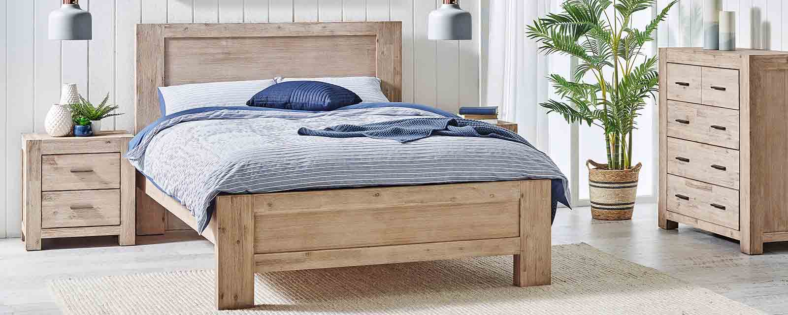 Complementary timber bed, tallboy and bedside table in a bedroom.