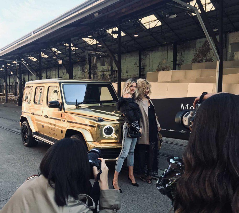 A gold car being displayed at Mercedes-Benz Fashion Week Australia.