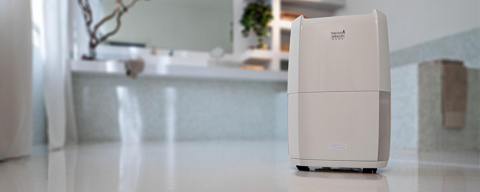 DeLonghi Tasciugo AriaDry Pure 2-in-1 Dehumidifier & Air Purifier in a bathroom.