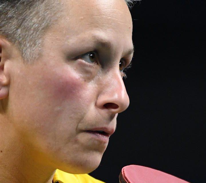 Paralympian Danni Di Toro with table tennis bat in hand.