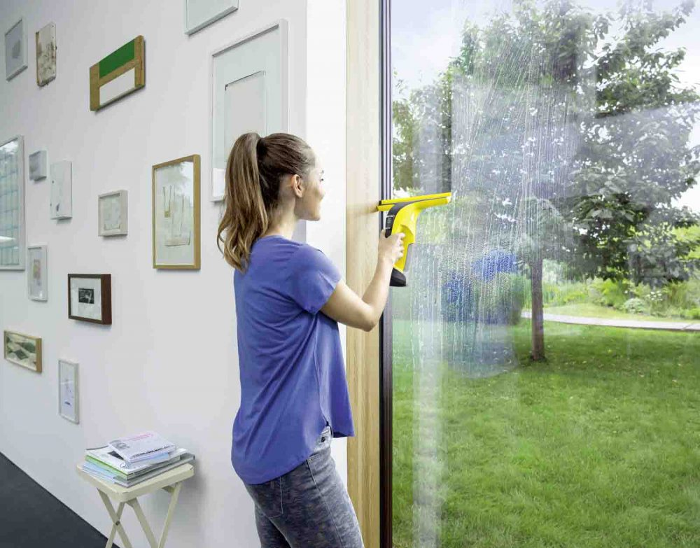 The Karcher WV6 Window Vac being used to clean a window.