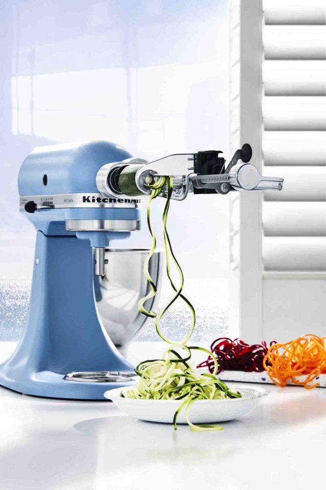 The KitchenAid Stand Mixer in Blue Velvet making zucchini noodles.