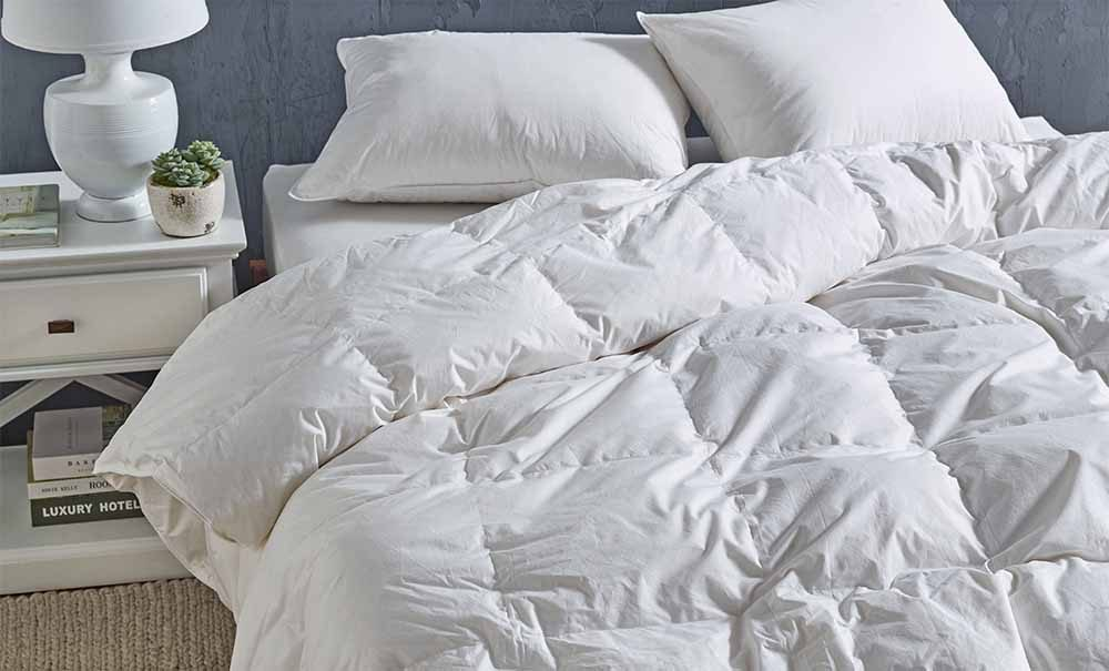 The L'Avenue 80-20 Duck Down & Feather Quilt on a bed.