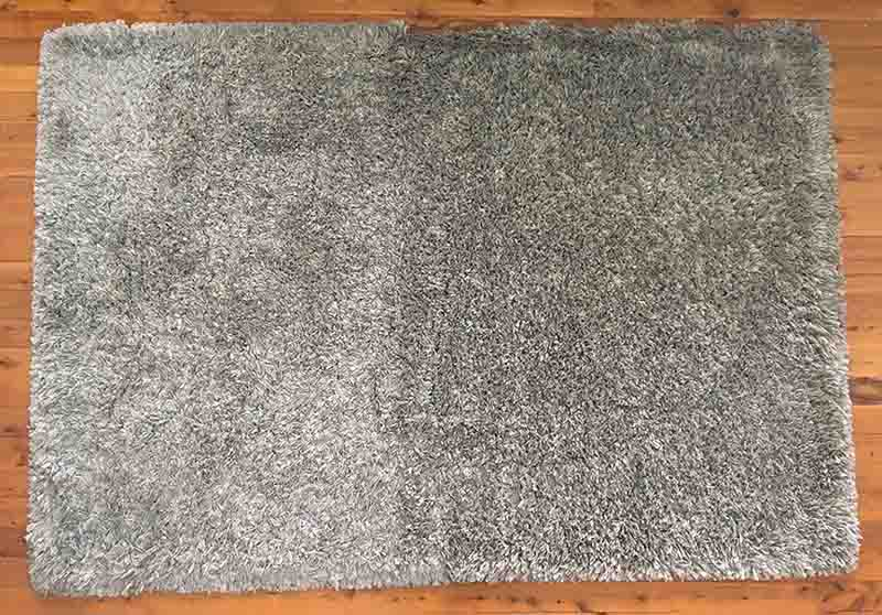 A floor mat that has been cleaned with the Dyson V11 Outsize Cordless Vacuum.