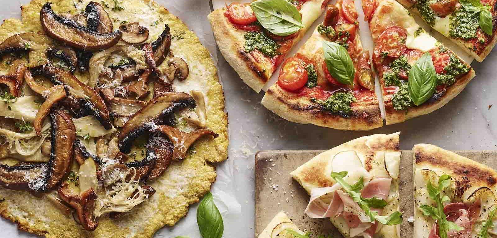 Three pizzas with cauliflower bases.
