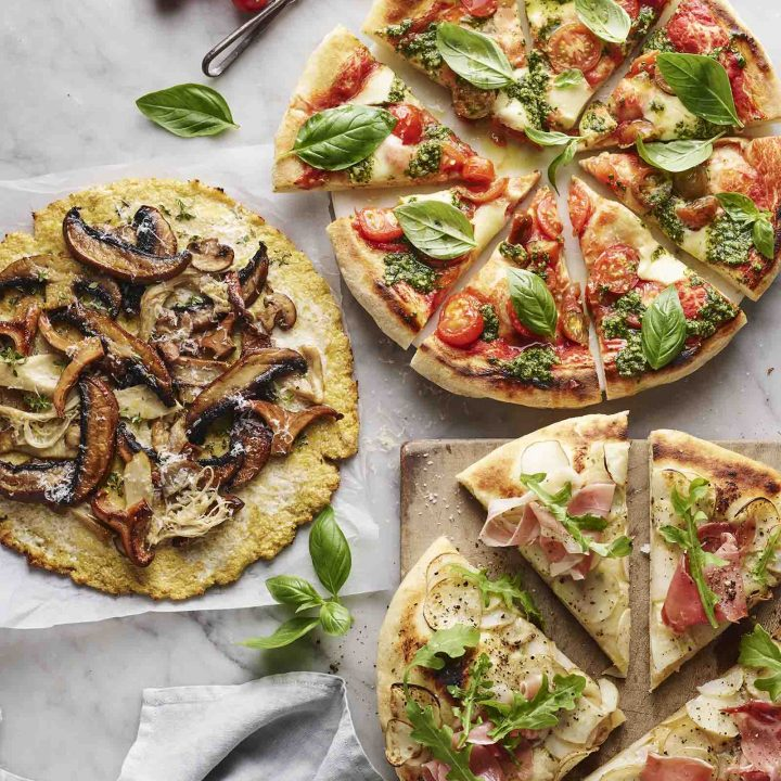 Three pizzas with cauliflower bases.