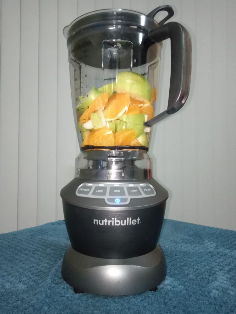 The NutriBullet Blender Combo picture with fruit before being blended.