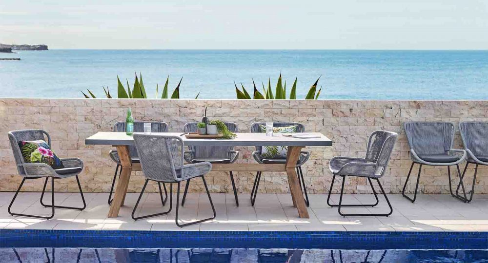 Paso Outdoor Bar Table with cement tabletop.