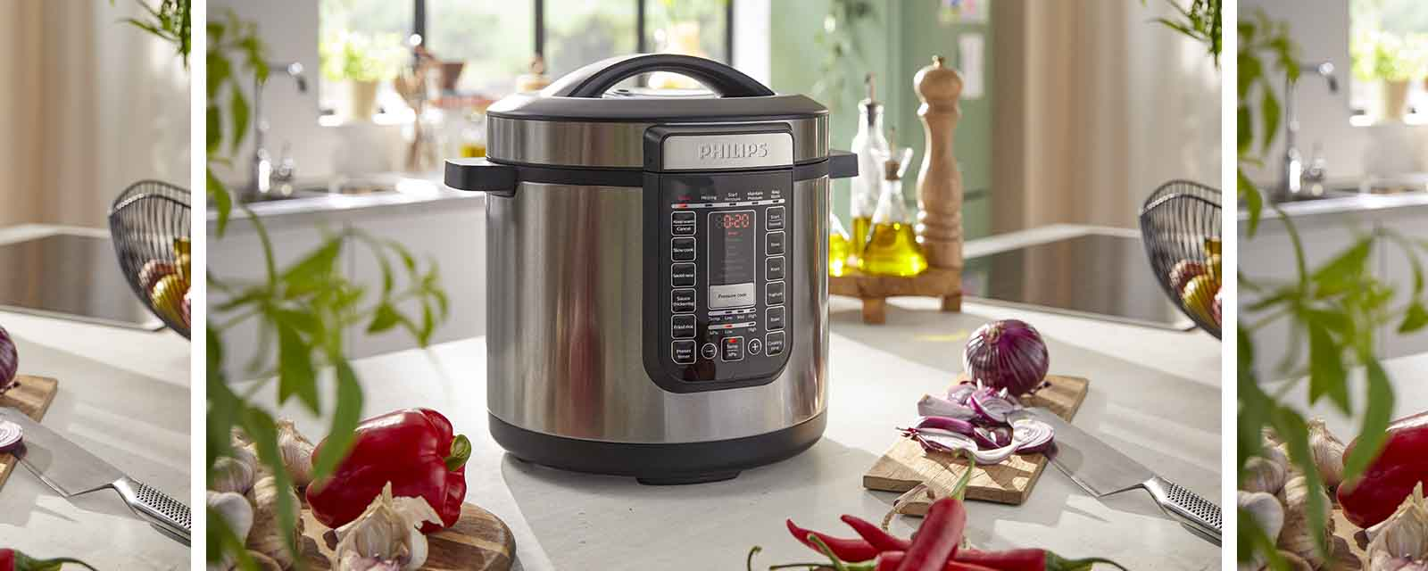 The Philips 8L All In One Cooker next to vegetables.