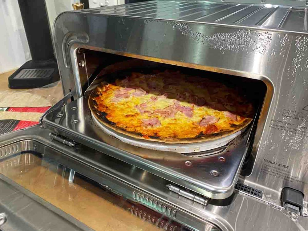 Cooking a pizza in The Smart Oven Pizzaiolo by Breville.