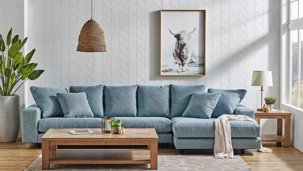 The Plaza 3.5-Seater Fabric Sofa with Chaise in a lounge room.