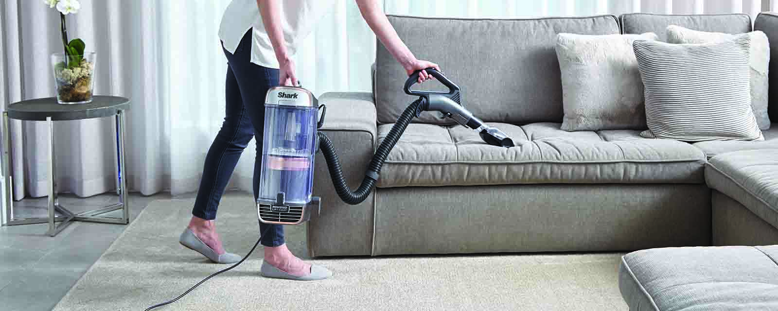 Cleaning a lounge with the Shark PZ1000 Vacuum Cleaner.
