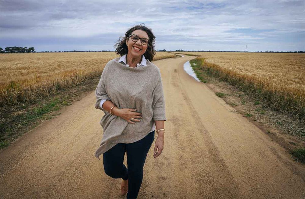 Simone Dudley, the winner of the 2020 Shine Awards Belief category, walking in a rural property.