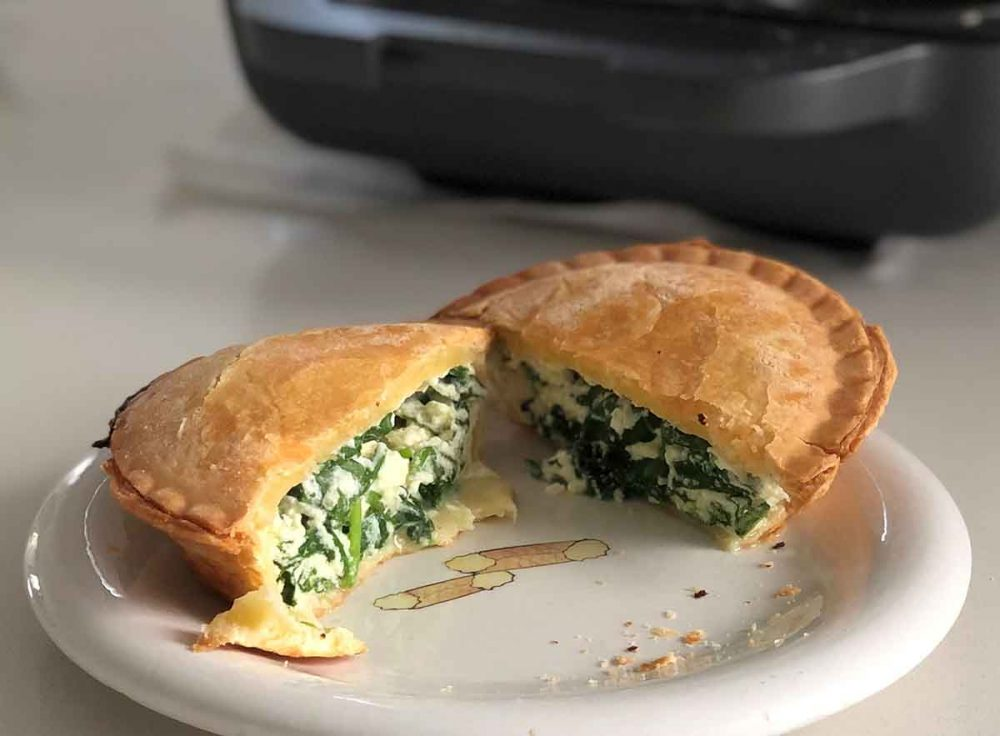 A Spinach & Ricotta Pie split in half.