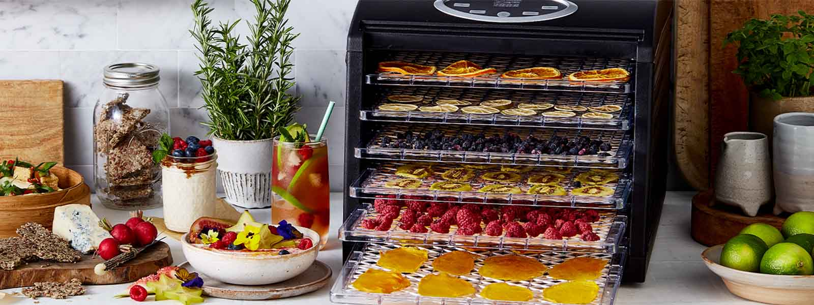 The Sunbeam Food Lab Electronic Dehydrator with various food on each shelf.
