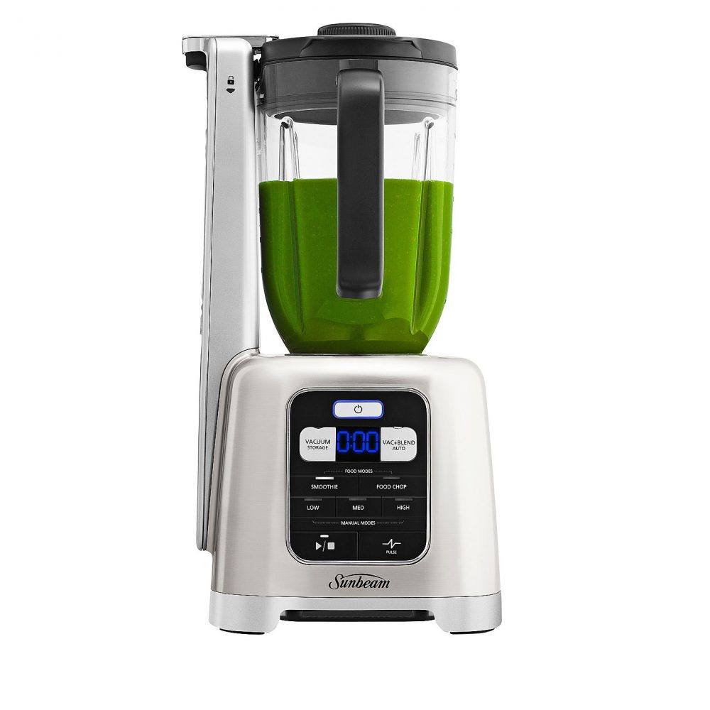 Sunbeam Nutriseal Vacuum Blender being used to make juice.