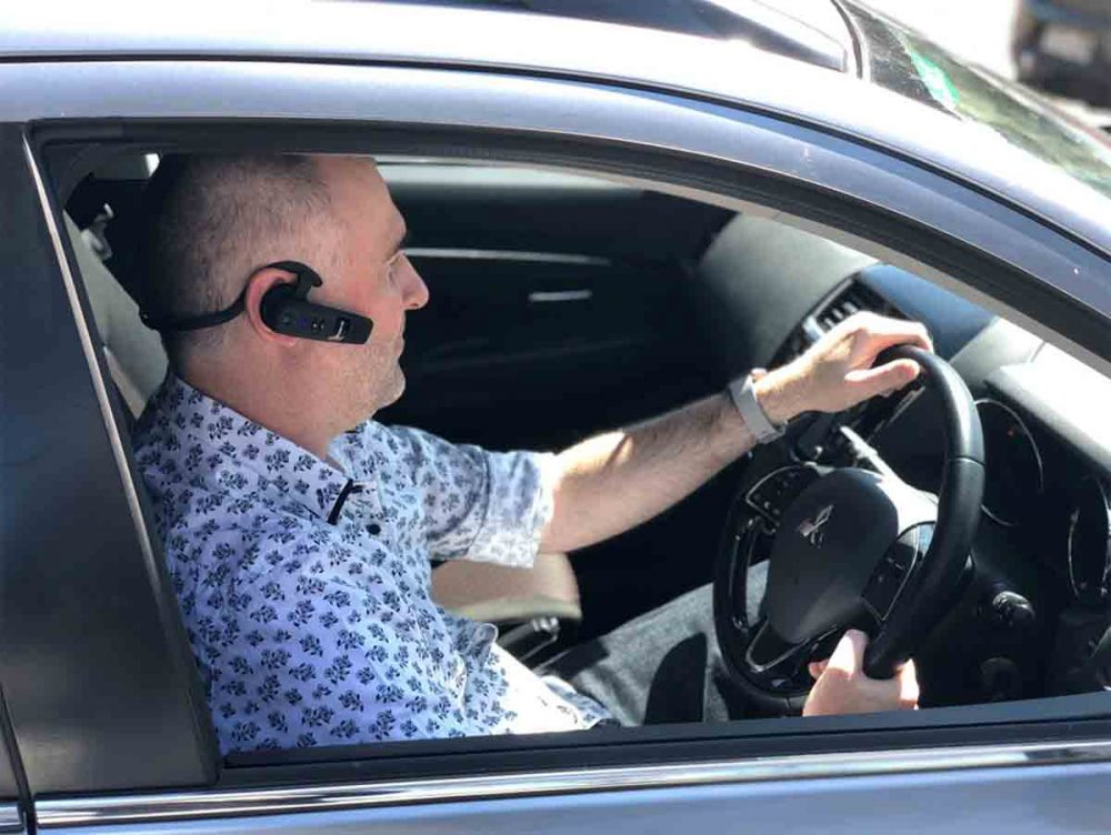 Our reviewer using the BlueParrott C300-XT Headset in his car.