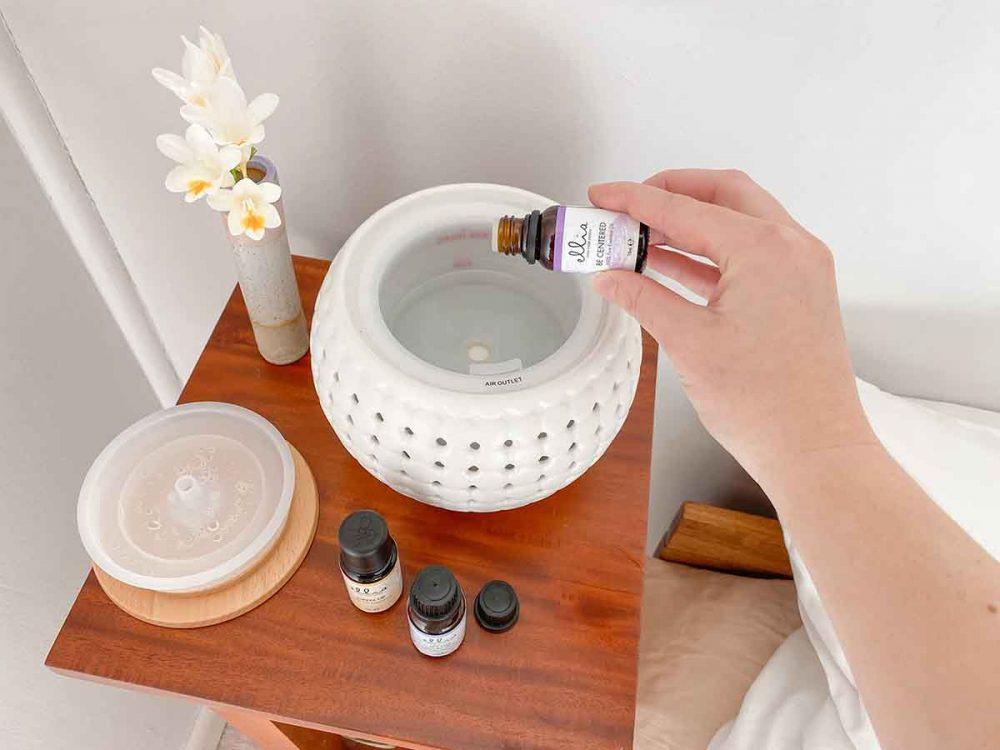 Putting oil in the HoMedics Ellia Gather Ultrasonic Aroma Diffuser.