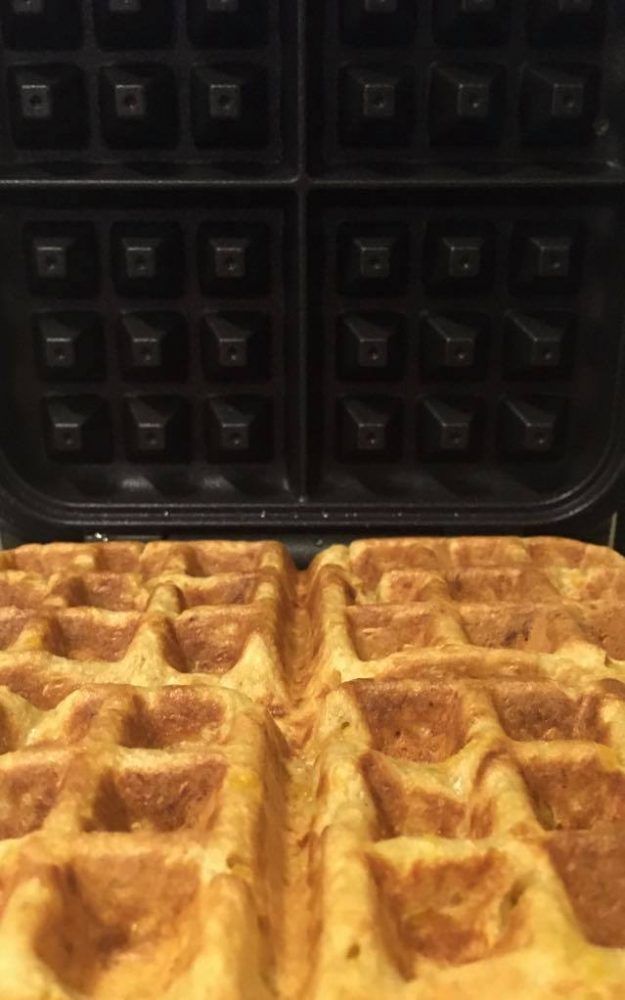 Waffles sitting in Sunbeam Shade Select Vertical Waffle Maker straight after being cooked.