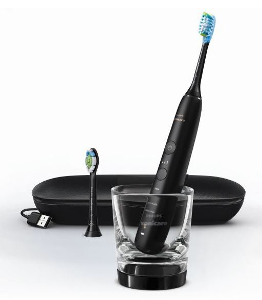 The Philips Sonicare DiamondClean 9000 electric toothbrush pictured with included accessories.
