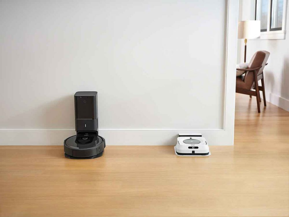The iRobot Roomba i7+ Robotic Vacuum and the iRobot Braava jet m6 Robot Mop both docked.